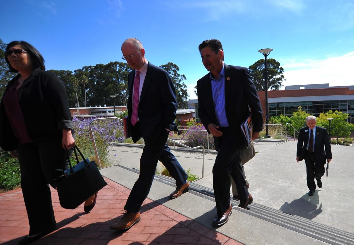 State Chancellor Eloy Ortiz Oakley (middle left) walks to the GE Building with his staff after meeting with CCC faculty  in Fireside Hall during his visit  Monday.