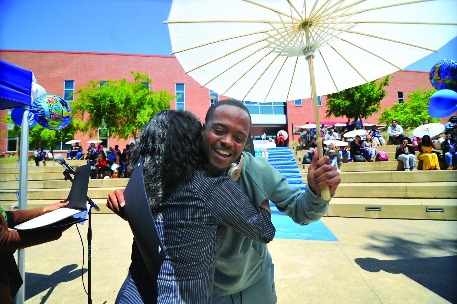 EOPS  student Justin Harvey  hugs  counselor  Dionne Perez   during the 16th Annual Student Recognition  Reception in the Amphitheater on May 8.