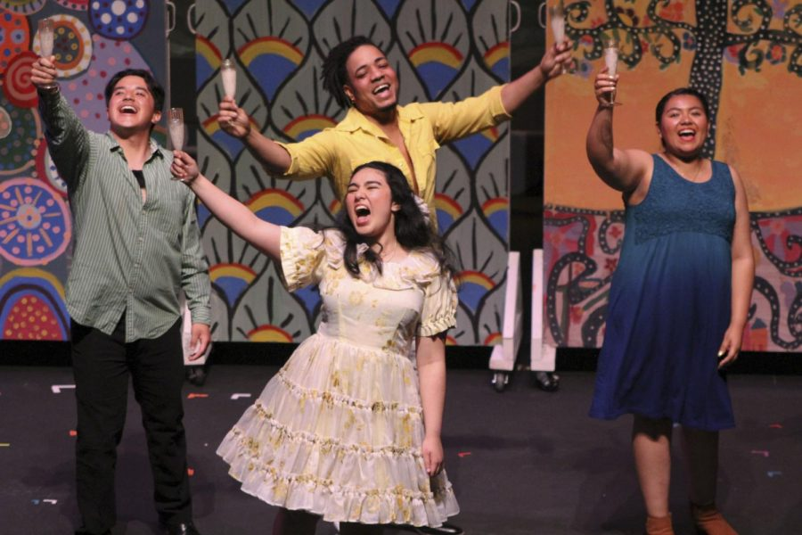 "Diego Loza (left), Jelaine Maestas (middle front), Gregory Lee (middle back) and Andrea Flores (right) raise a glass of champagne during a scene from ""The Hispanick Zone."""