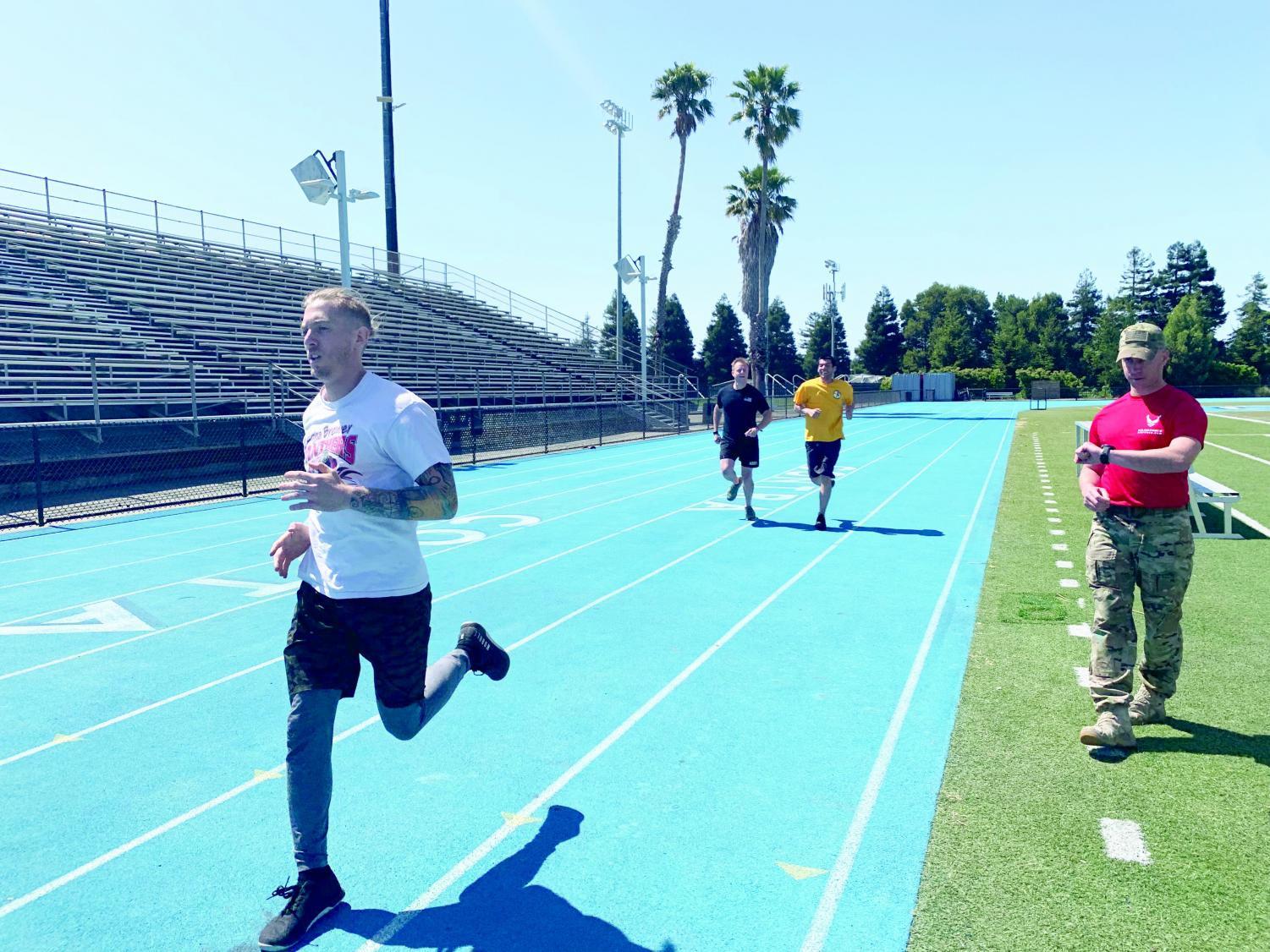 Zachary Frappier (left) strides as he crosses the finish line during the 800 meter run at the Armed Forces Day event in Comet Stadium on May 3.