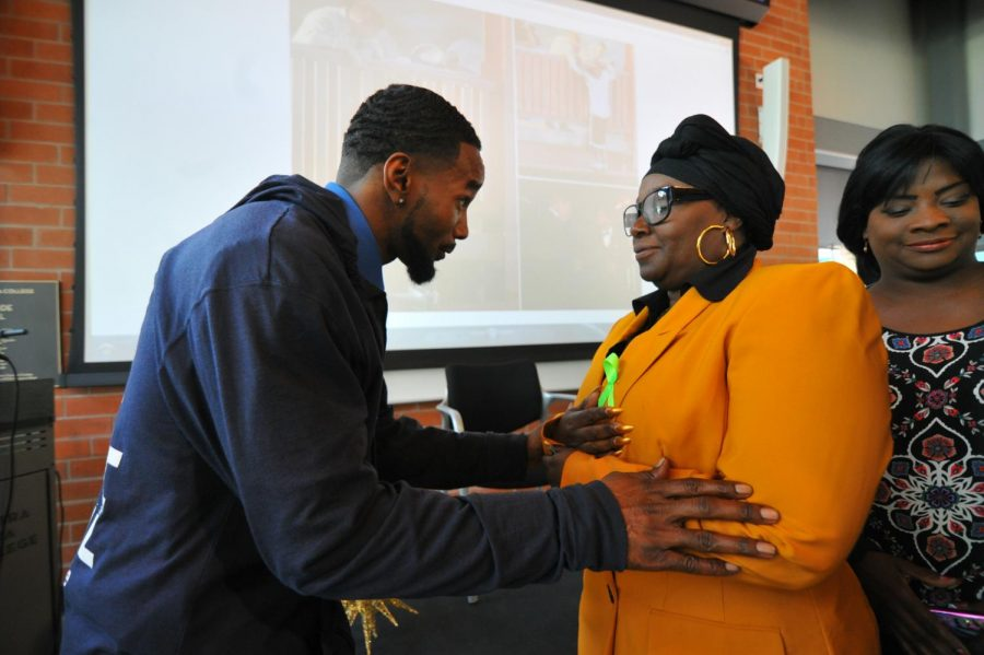Health and Human Services major Sandra Simon recives words of support form suicide attempt survivor  Kevin Berthia during the May 17 Psychosocial Spring Conference.