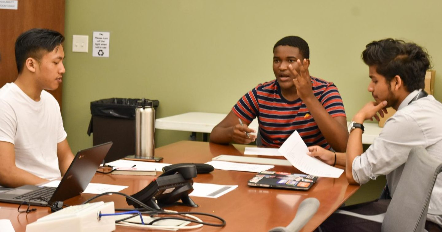 Chris Siriyam (left), Associated Student Union President Preston Akubuo-Onwuemeka (middle) and Shreejal Luitel (right) meet in the Associated Students Union office in SA-109.