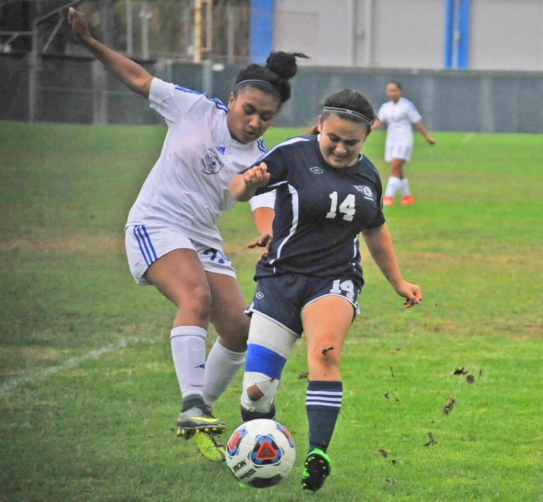 Comet defender Ashley Portillo (right) battles for possession of the ball during a home game in the 2017 season, the last time the women's soccer team played.