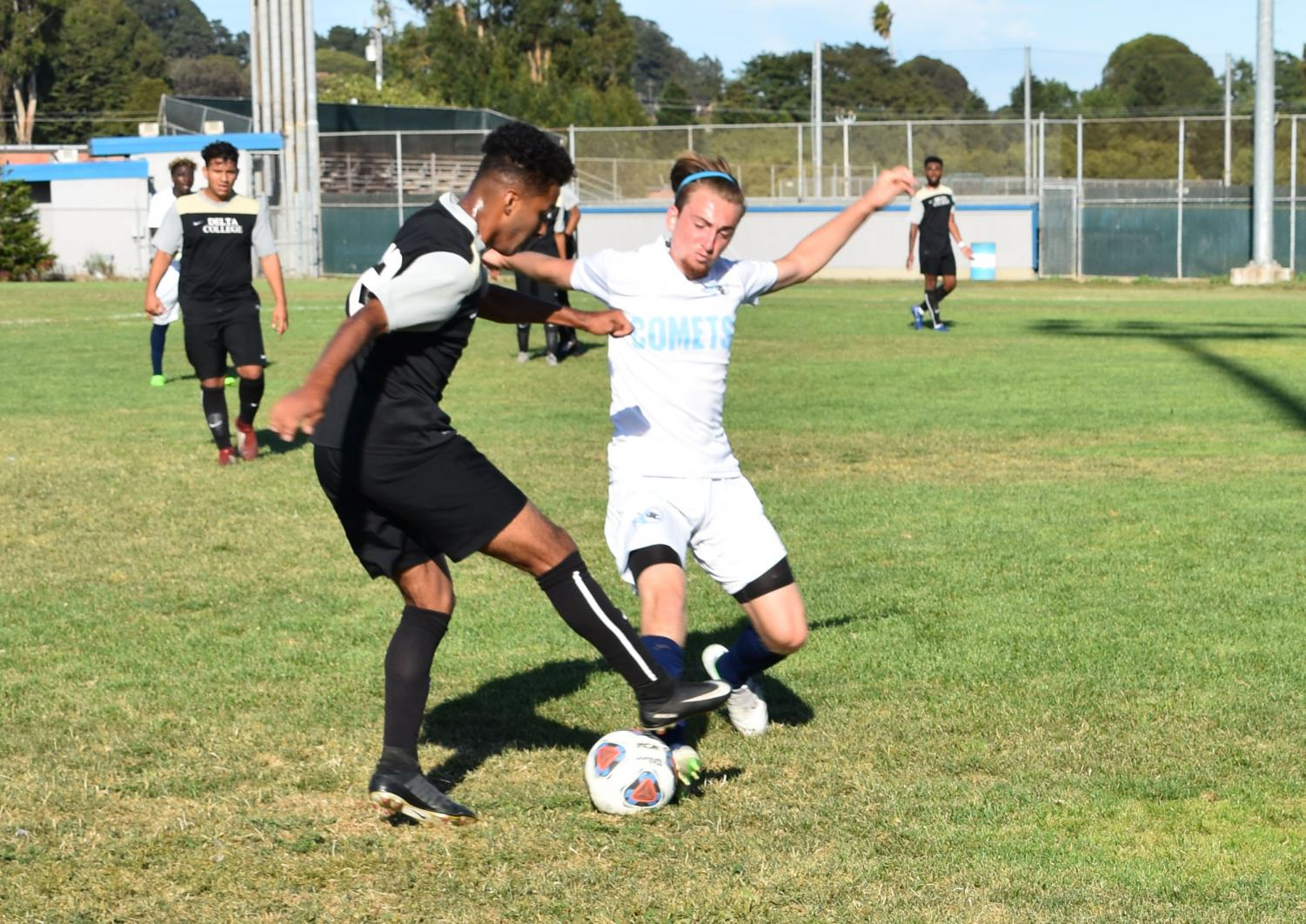 Comet player Nick Silva (right) fights for the ball duringa  6-0 blow out home loss to San Joaquin Delta College, the first of a five-game losing streak to start the 2019 season.