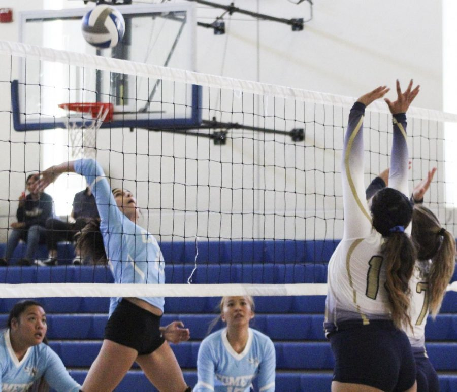 Right+side+hitter+Nadia+Thomas+%28left%29+spikes+the+ball+over+the+net+in+the+Comets%E2%80%99+first+game+of+the+season+against+Yuba+College+in+the+Pinole+Middle+School+Gymnasium+on+Sept.+18