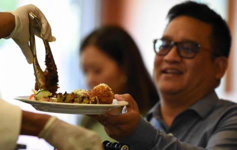 Rodolfo Santos enjoys a plate of the Mediterranean cuisine served during the Iron Chef event held Sept. 5 in Aqua Terra Grill.