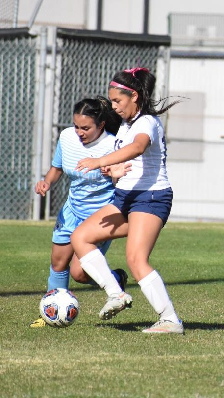 Comet forward Raquel Alvarez (left) dribbles up the right side of the field as Yuba left back Priscilla Gonzalez  tackles her at the Soccer Field  Friday.