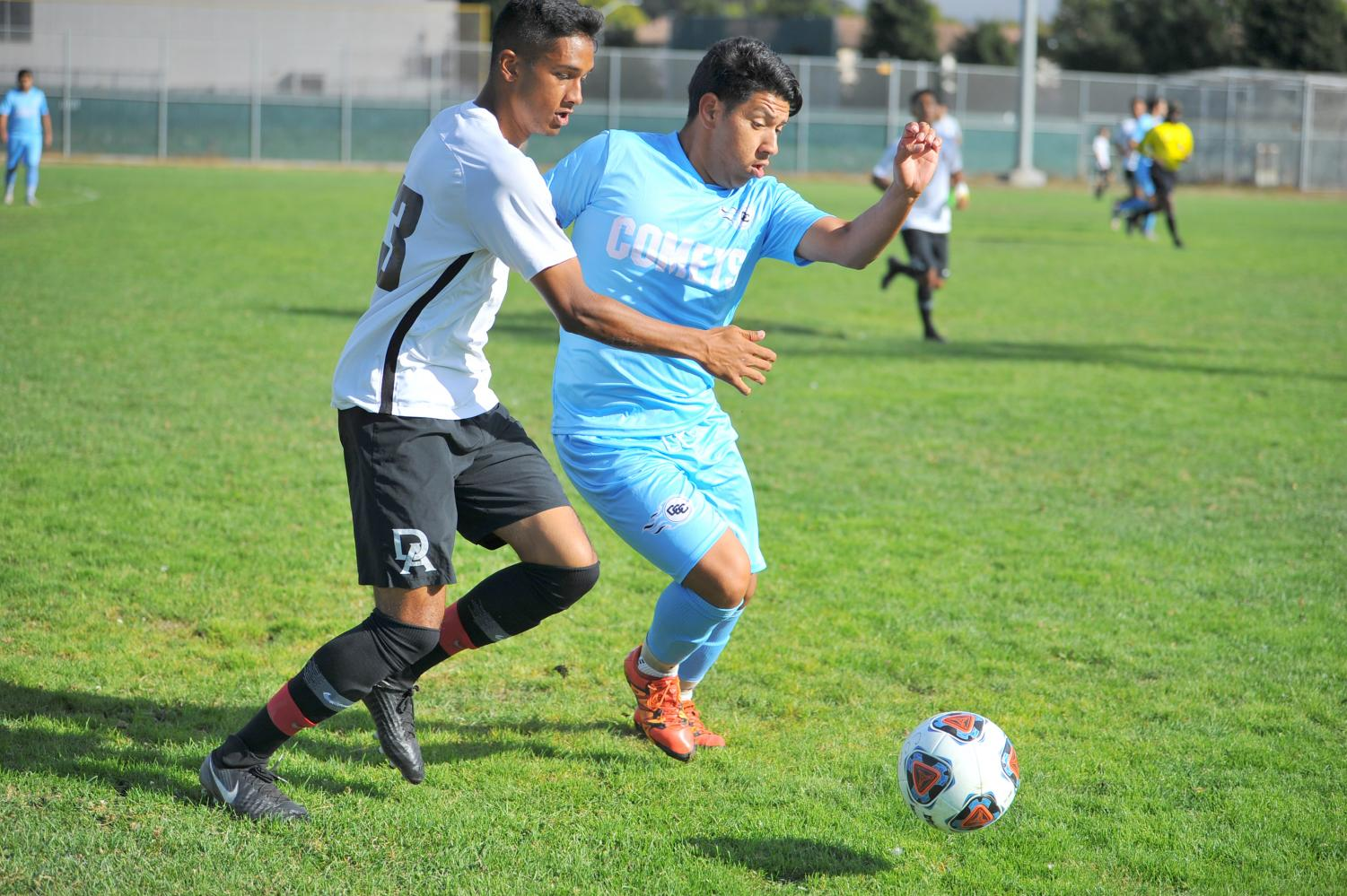Comet midfielder Victor Rodriguez tackles a De Anza College midfielder during Contra Costa College's 2-0 loss on Friday on the Soccer Field.