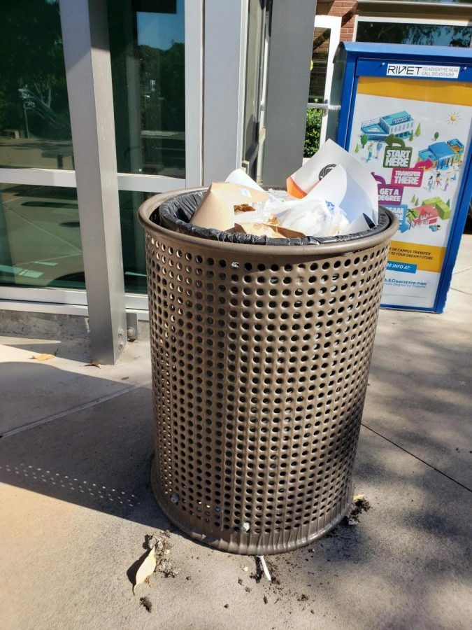 A+trash+can+near+the+Student+Services+Center+is+filled+to+the+brim+with+garbage+due+to+significant+custodial+worker+and+equipment+shortages+on+campus+leaving+some+areas+on+campus+unattended.