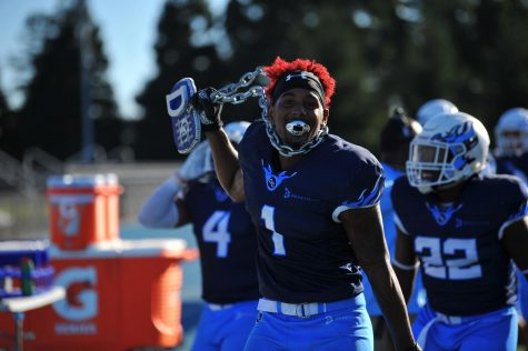 Comet defensive back Dayvonne Greenwood  celebrates after forcing a fumble and recovering the ball from Merced College on Saturday.