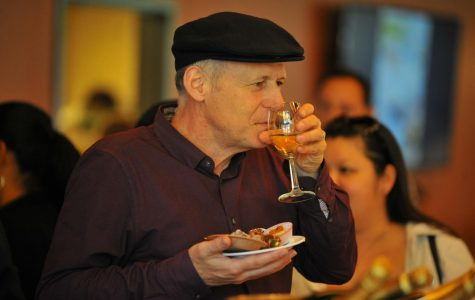 Pianist Walter Bankovitch takes a sip of champagne at the annual Chocolate and Champagne event in Aqua Terra Grill on Oct. 12.