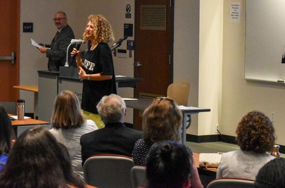 Liberal Arts Division Dean Jason Berner (background) and acting President Mojdeh Mehdizadeh address faculty and staff at the All-College Day event held in GE-225 on Aug. 23.
