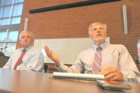 Interim Chancellor Eugene Huff (right) and Former Chancellor Fred Wood (left) discuss the formation of an interim presidential hiring committee at a Fireside Hall meeting with CCC staff on Aug. 15, 2019 during a public forum.