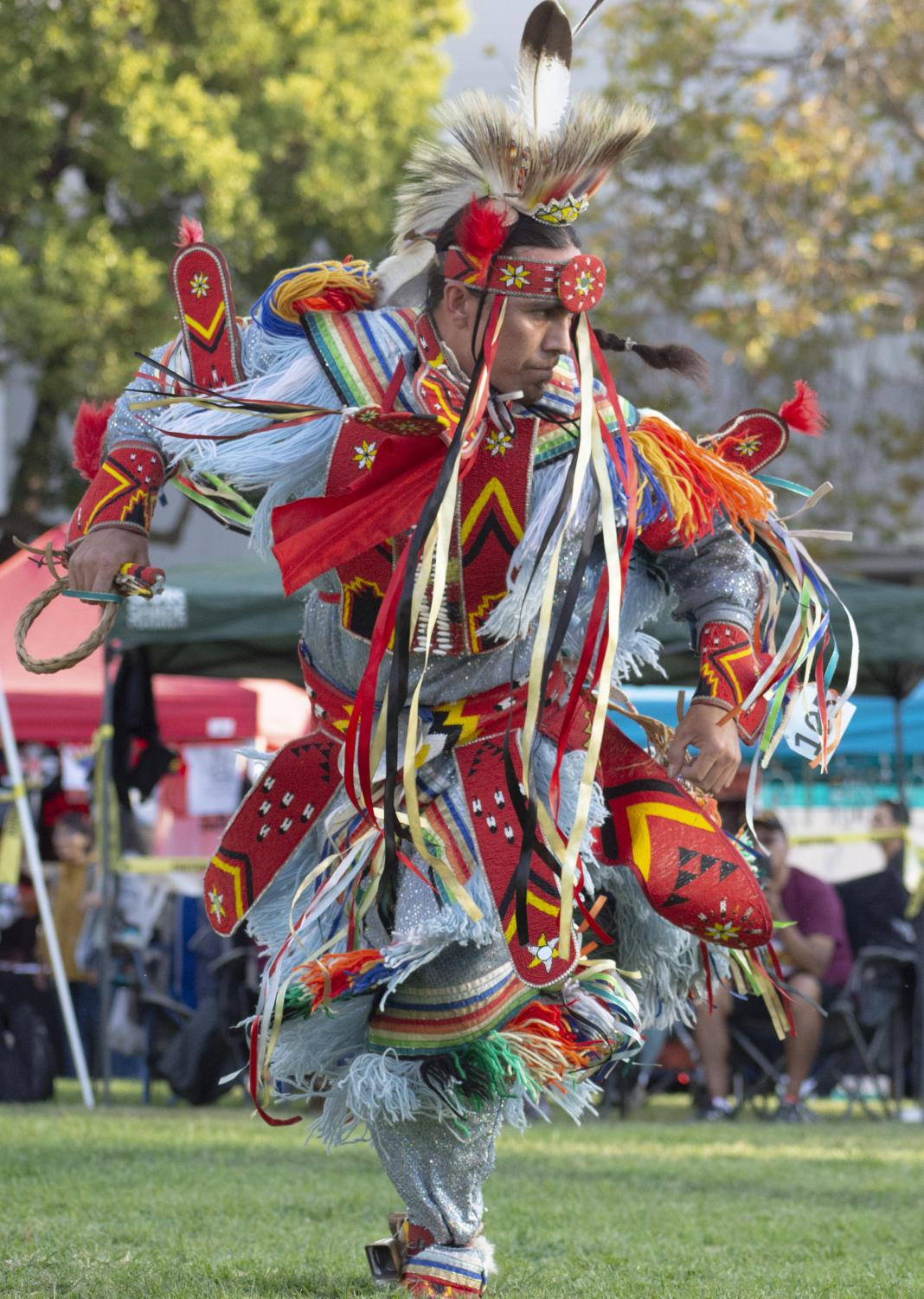 An+adult+contest+dancer+competes+during+the+Berkeley+Indigenous+Peoples+Day+Pow+Wow+on+Oct.+12+at+Martin+Luther+King+Civic+Center+Park+in+Berkeley%2C+California.