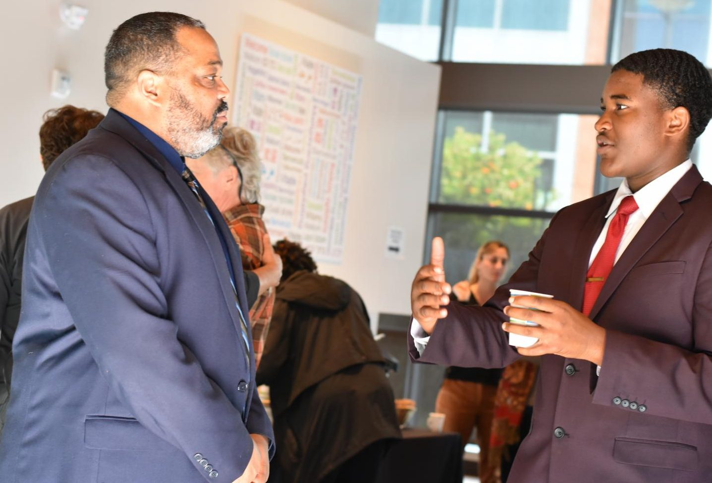 Interim President Damon Bell (left) speaks with Associated Student President Preston Akubuo-Onwuemeka during a meet-and-greet session for the new president at Fireside Hall Monday.