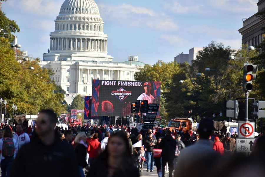Large video screens near the U.S. Capitol display images of the Washington Nationals World Series victory parade on Nov. 2. The screens were placed to show the final phase of the parade, when the players and front office staff gave speeches, allowing those unable to find a seat to watch.