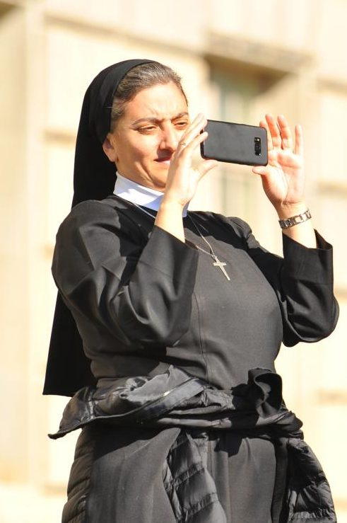 A+nun+takes+a+photograph+on+her+phone+of+the+historic+World+Series+parade+in+Washington+D.C.+on+Nov.+2.