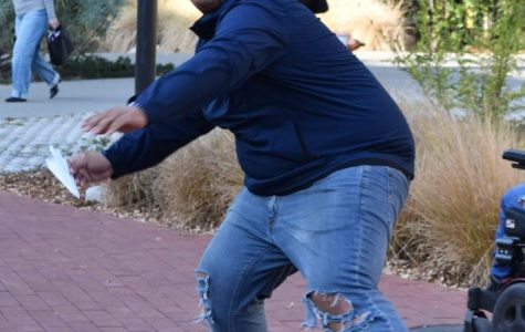 Student Armani Jones prepares to launch his paper airplane during the Fly High competition held in Campus Center Plaza on Nov. 19.