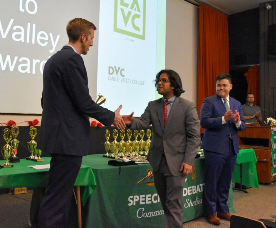 Speech+team+member+Aman+Butt+accepts+a+second+place+award+in+the+informative+speech+category+at+the+Valley+to+Valley+Speech+and+Debate+Tournament+held+at+Diablo+Valley+College+on+Nov.+26.