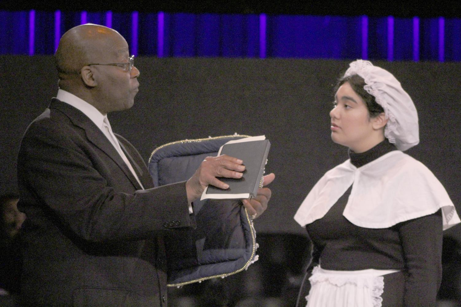 """Elizabeth Donderstock (right), played by Jelaine Maestas, speaks with Rev. Tollhouse (left), played by Elijah Sterling, during a rehearsal of """"The Book of Liz,"""" which concluded its run in the Knox Center this past weekend."""
