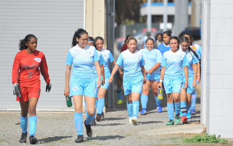 The women's soccer team (3-10) walks to the Soccer Field for a home game on Aug. 27 during their first full season in over two years.