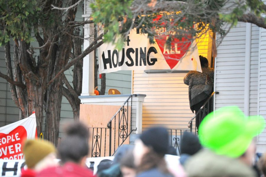 Supporters of Dominique Walker, 45, and Sameerah Karim, 41, who began living illegally at the house at 2928 Magnolia on Nov. 18 and started the Moms4Hous- ing organiz- ation, gather outside of the  house after the mothers were evicted in Oakland, California on Jan. 14.