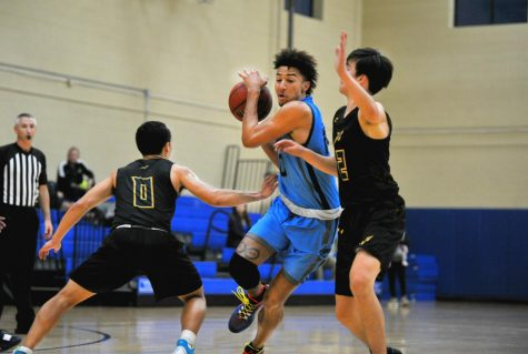Contra Costa College forward Sam Johannessen dribbles in between two Napa Valley College players during Napa's 68-63 win at the Police Activities League gym in Richmond on Feb. 12.