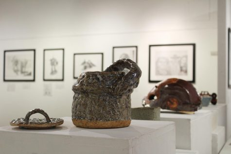 Drawings and sculptures created by Steven Berndt are pictured from left to right — ceramic baskets, a replica Iron Man mask, a ceramic bowl and a replica of Cobra Jeep from the G.I. Joe franchise. This artwork is available for viewing at the Eddie Rhodes Gallery in A-5.