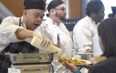 A hungry student is served by a chef at the spring semester culinary arts Iron Chef Competition on Feb. 6