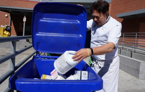 Culinary department Chairperson Nader Sharkes places plastic waste in the recyclable container adding to his department's focus on decreasing the carbon footprint of the campus.