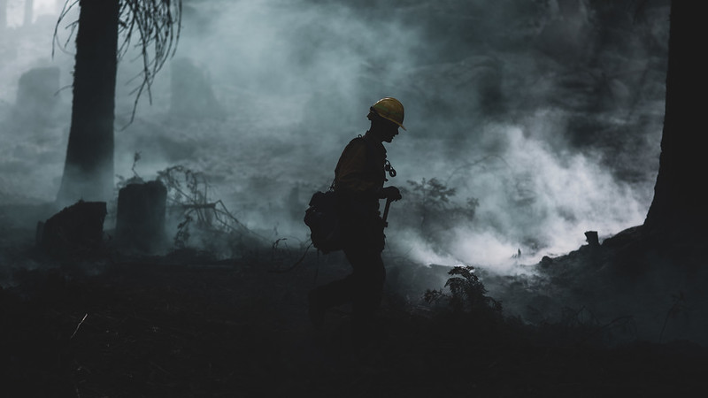 A U.S. Marine assigned to the 7th Engineer Support Battalion, 1st Marine Logistics Group, conducts wildland firefighting operations with National Interagency Fire Center personnel near the Sierra National Forest in California, Sept. 26, 2020.