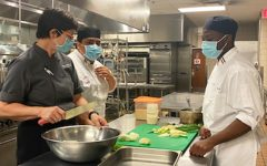 Culinary arts professor Elisabeth Schwarz teaches students cutting techniques during a face-to-face class in the Aqua Terra Grill kitchen on Sept. 26.