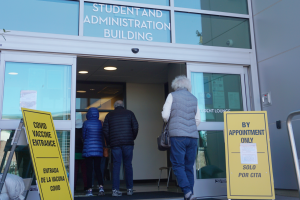 Patients enter the Student Lounge to check in for their vaccine appointments on Jan. 25. Contra Costa Health Services has taken over the Student Lounge, the Student Dining Room and the Fireside Hall to be used as stations for the vaccine clinic.